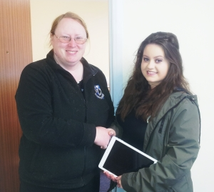 Grace Greenan collects her iPad Air from Carol Lambe, Community Development Officer for Monaghan Co Co